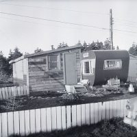 black and white photo of a trailer park